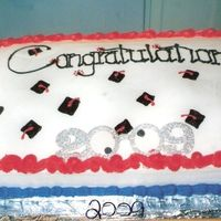 Graduation Cakes This was done for our Homeschool Banquet this year. All buttercream icing with a pair of 2009 Glasses that i took the arms off of and made...