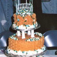 Basket Full Of Flowers Cake This was my first wedding cake. It was for a relative who was having a western theme wedding complete with groomsmen in overalls, and straw...