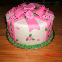 Wilton Cake Class 3- 1 St Cake I used foam cakes. Covered with Wilton fondant and the Wilton Ribbon doubled. I used the ribbon cutter and the punch out tool to do the...