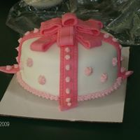 My First Cake This is my first time decorating cake. I had a little trouble forming the bow at the top. I used fondant but I think the ribbon strands...