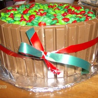 Christmas Barrel Cake This is a cake i made for christmas. I used yellow cake with chocolate ganache filling. The outside is made of kit kats and m&m's...