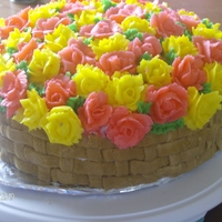 Flower Basket This is a cake I made for my grandma's birthday. The cake is yellow with apple filling. The outside is a basket weave with flowers on...