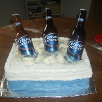Beer Cooler Birthday Cake The cooler is a 3 layer yellow with chocolate frosting covered in fondant. The bottle on the left is made of sugar, the other two are real...