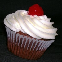 Classic Cupcakes Made for an office party. Lightly cherry-flavored chocolate cupcakes with buttercream icing.