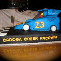 Slingshot Race Car Cake This was a cake made for a boy who just graduated from high school. He races these cars and his parents wanted to have a cake made to look...