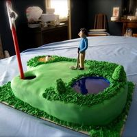 Golf Cake  This is a chocolate cake with vanilla butter cream frosting. Its covered with fondant and I used sanding sugar for the sand trap and corn...