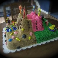 Princess/sand Castle Cake This is a chocolate cake with vanilla butter cream filling in the castle and chocolate ganache filling in sheet cake portion. I made this...