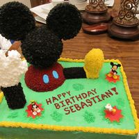 Mickey Mouse Clubhouse Birthday Cake I made this for my nephew's first birthday. This is the third cake I've made and quite a learning experience. The shoe and leg...