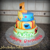 Sesame Street This design is by Pastrychic on Flickr, I just loved it when I saw it..her version is much neater than mine.Bottom tier: Banana cake with...