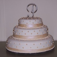 Simple, But Elegant   Strawberry cake with chocolate filling and cream cheese frosting, covered with rolled fondant.