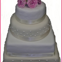 Pink Flowers Wedding Cake Wedding cake with pink roses on top