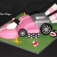 Pink Mario Kart Cake. I made this 3D hand carved mario kart (from the wii) for my little girl's 5th birthday party today! She's obsessed with Princess...