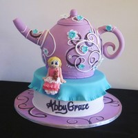 Whimsical Tea Pot Cake Handmade figurine from fondant. Teapot is handcarved, handpainted with overlaying fondant swirls and flowers. Name is hand painted. :)