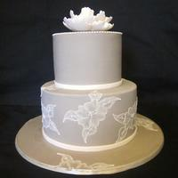 Brushed Embroidered Wedding Cake Taupe coloured icing (looks a little grey in this pic). Then some open rose brush embroidery... and small piped dots on the top tier. And a...
