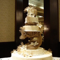 "Sugared Splendor Six tier ivory buttercream, bottom tier is 48"" in diameter, then a 24"" and a 16"", and on top of pedestall is an 18"", 14..."