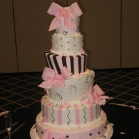 Pretty In Pink Six tiers with buttercream icing and fondant bows. Stripes and pearls were also out of fondant.