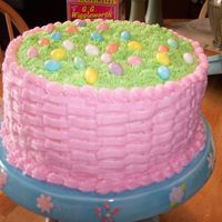Easter Basket Cake   8 inch chocolate layer cake with cookies and cream filling/BC decorations. Jellybean eggs.