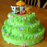 Littlest Pet Shop Picnic This cake was very last minute for an 8 year old girl. I wish I had more time so that I could have hand sculpted the animals, but the...