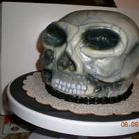 Skull Cake  this was actually a birthday cake that I made for my sister's 18th birthday. It's chocolate cake (about 5 layers) with chocolate...
