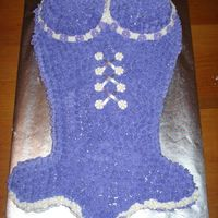 Purple Corset I made this corset cake for my friend's 21st birthday! I had to carve the cake from scratch and make small round cakes for her top......