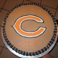 Chicago Bears Birthday Cake Chocolate cake and I did the piping gel transfer for the team logo. All BC frosting.