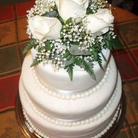 60Th Diamond White Anniversary  3 Tiered Chocolate Cake, filled and iced with buttercream, covered with white fondant, brushed with pearl dust, and accented with ribbon,...