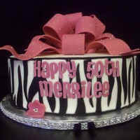 Zebra And Pink Another zebra and pink cake. BC icing with fondant stripes and bow. Client wanted to add some sparkle.
