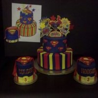 "Superman  WASC iced in royal blue BC, MMF and RI accents. 8"" and 6"" stacked rounds. Mini cakes are 3"" round X 4"" tall. Original..."