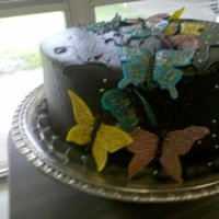 Butterflies Chocolate cake with peanut butter mocha icing. Fondant butterflies accented with gold dust.