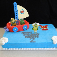 Wonder Pets This was half chocolate, half yellow 1/4 sheet with BC. Gumpaste accents, RKT boat covered in MMF with gumpaste accents. TFL!