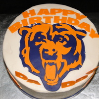 Chicago Bear's Cake This was a strawberry cake with BC made for my hubby's 34th birthday. The Bear and letters were cut using gumpaste.