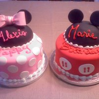 Minnie And Mickey The hats were made of RKT covered in white choc to smooth it out then black fondant. The ears and bow were gumpaste. Thanks for looking...