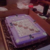 Bingo Cake this cake was for the 60th birthday. We used all her special numbers and favorite colors and even found some good luck charms to place on...