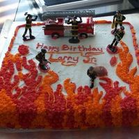 Fireman Picked up the decorations at a local cake store and freehanded the rest.