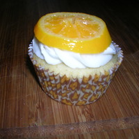 "Orange Cupcakes   made for my mom""s birthday. they are orange vanilla bean cupcakes with vanilla bean buttercream topped with a candied orange slice."