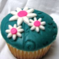 Teal Cupcakes My first time creating fondant cupcake disc toppers. It was much easier than I thought! Wilton impression mat and cutters. MMF topper and...