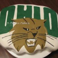 Ou Bobcat Logo Cake   Yet another tailgating cake. Ohio University's logo. The bobcat is Rufus, their mascot. MMF covered and accented.