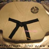 Black Belt Karate Cake  2D carved carved cake iced in buttercream with MMF decor. The patch is dusted with Wilton Pearl Dust. Thanks to the cc member who did this...