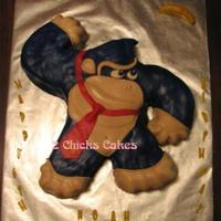 Donkey Kong   2D carved chocolate cake with MMF. His head doesn't seem tall enough but it matches up with the template I used.