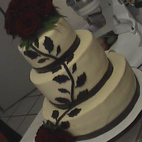 Brown Branch And Leaves Wedding Cake Rum ponque, rum buttercream, chocolate fondant decorations and natural red rose. The filling is dulce de leche with cream cheese rum..