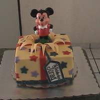 Mickey Gift Box Mickey gift box cake. WASC with blackberry filling, buttercream frosting with detailes in fondant and gumpaste/fondant. Thanks to...