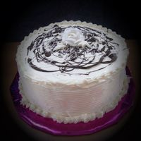1Whiterosecake001.jpg   All butter cream cake with chocolate mouse filling.