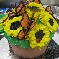 Flower Pot I made a jumbo cupcake look like a flowerpot, added some chocolate butterflies and oreo sunflowers.