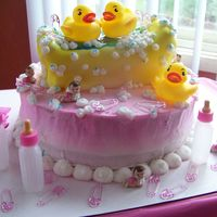 Ducky Baby Shower This cake turned out awesome, thanks to two great minds thinking alike! I gave my sister an idea for the cake and she ran with it! This...