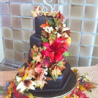 Fall Wedding Cake This is a 15' hex 10'rd 9' hex and 6' rd. covered with Satin ice dark choc. fondant. This cake I did for my stepsons...