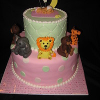Baby Shower Cake With A Animal Theme 10,6' wasc baby and all animals were from gumpaste, first time I used my baby mold, I was so excited and it was soooo easy to use.