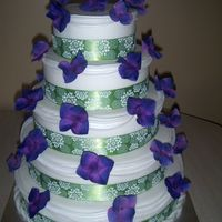 Green And Purple Wedding Cake First real time I did this many swags on a cake.Glad to have that done and over with. The overall look was great.I brushed 5 coats of dust...