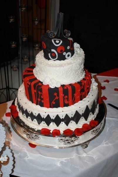 Black Red White Wedding Cake bride told me it was up to me, she wanted something different.The cake was HUGE, bottom tier was 19 inches and 7 inches on the slant.She...