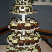 Chocolate And Avacodo Cake Cupcake tower with monogrammed initials in the cupcake.with buttercream icing.