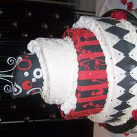 Hpim5833.jpg topsy turvy cake and the bride left it for me to make the design.she wanted funky and different. and she loved it! the second layer is a...